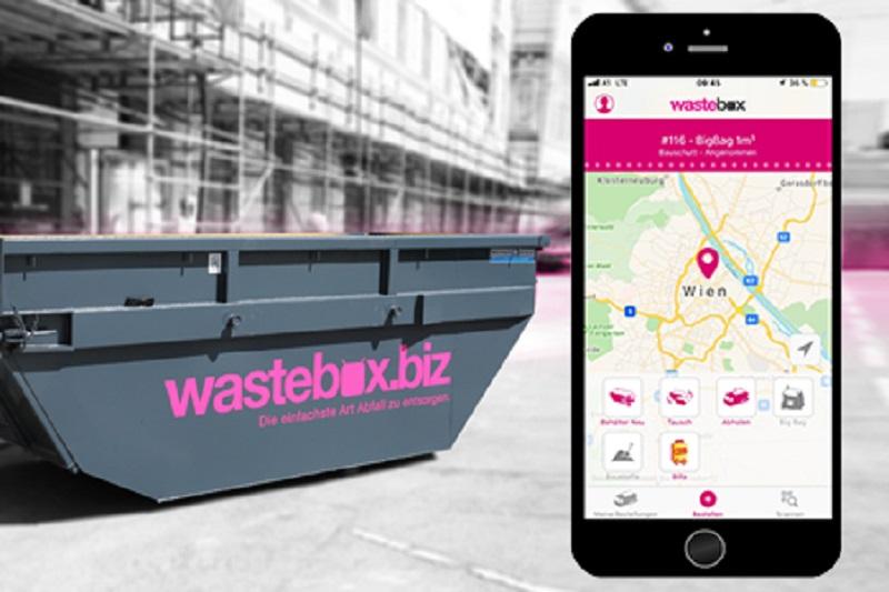 Abfallmulde im wastebox Design mit Mockup der wastebox App am Smartphone