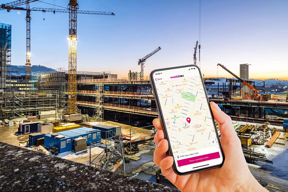 Smartphone with map screen, construction site