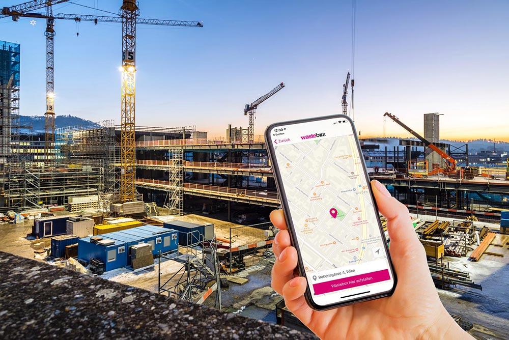 Smartphone mit Karte zeigt Standort einer Baustelle in Wien.